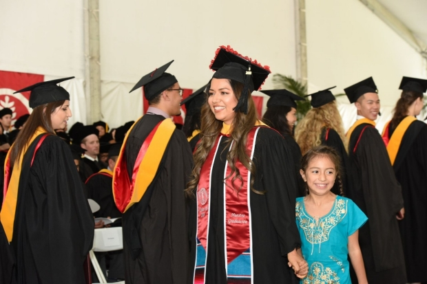 The CHPR program includes students from diverse stages of life, such as Adrienne Lazaro, shown with her daughter during Commencement 2018. Lazaro, as an alum, continues her connection with CHPR by serving on its Advisory Board and Admissions Committee